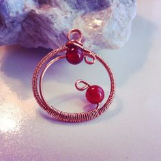 Copper and Carnelian wire wrapped pendant. Symbolic of both the root and navel chakra, Carnelian is though to stimulate both activity and creativity.   #alisonsgemstonedesigns  #gemstoneenergy  #alisonfathers #artisancrafts #handcraftedjewelry #wirewrapped  www.alisonsgemstonedesigns.com