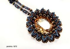 Beaded pendant by Simone Helmig.
