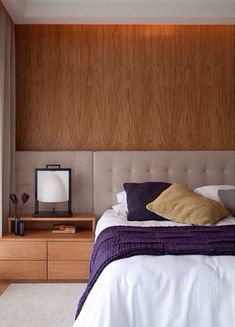 Love how the wide extended upholstered headboard and wood make a feature wall in this contemporary modern bedroom | bedroom decor ideas