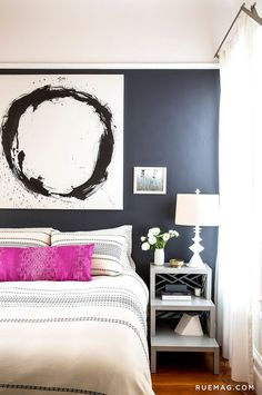 Black and white bedroom with purple pillow on bed