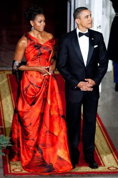 January 19, 2011-Mrs. Obama joins the President at the State dinner at the White House in a vibrant Alexander McQueen gown.