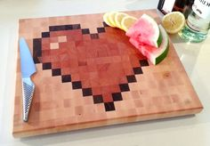 End-grain hardwood chopping board with retro pixel art design - HEART