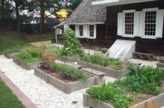 Raised garden beds...love the white gravel path