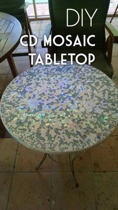 Check out this easy tutorial on how to make a #DIY CD mosaic tabletop. Love it! #HomeDecorIdeas