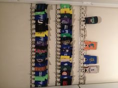 Coozie display with cafe rods, rod clips, bulldog clips, and 3m hooks. Love the outcome!