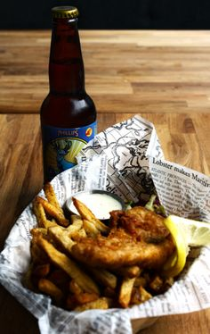 Fish and chips with a beer.