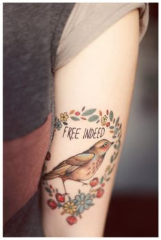 """free indeed"" perfect bird tattoo with a touch of folksy indie. i love it."