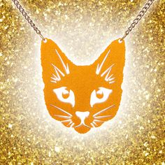 The perfect gift for any cat lover, or for yourself! The orange Perspex used to create this necklace is super special as it has gorgeous extra fine glitter running through it to make it even more eye-catching. It's also a lovely gold colour on the back, so it works as two necklaces! Wear it with something simple to work it as a statement piece, or with striking bold colours to create a contrast look as unique as yourself! 😻🧡 Gold Colour, Orange Color, Extra Fine Glitter, Cat Patch, Cat Necklace, Steel Chain, Natural World, Cat Lovers, Contrast