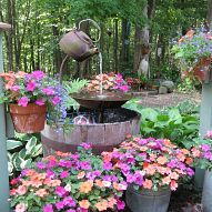 Teapot Fountain--basil, dill, lavender, and nasturtiums would be pretty, too!