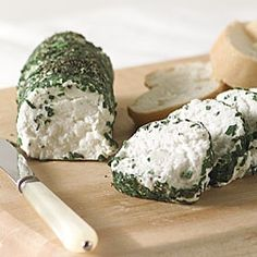 I used parsley, thyme, dill, and rosemary. A nice way to dress up an otherwise inexpensive goat cheese for a party - and very easy to make ahead!