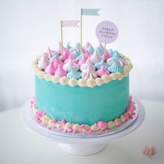 Decorate your cake with pastel meringue kisses.