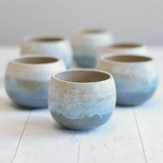 wintry pallet . . . For me the best thing about these Yunomi inspired bowls is the glaze combination. It does something unique on every single one. A drip may form over the curved body or a delicate new blue hue will emerge where the glazes overlap and mingle during the firing. I have a few of these little matcha tea bowls left in my shop- equally handy for mulled wine.