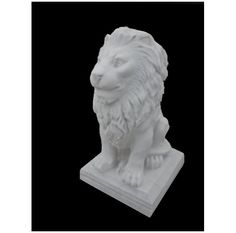 Marble Leon sitting , furtive capturda image of this marble lion sitting regal look porte fierce king of the jungle in marble . Facial , body traits were cared for by Master Arturo Flores professional sculptor .