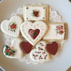 Valentines Day cookies. Rose flavored and decorated with royal icing. White.