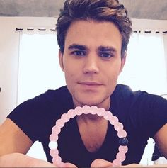 Paul Wesley showing off his new pink lokai!
