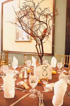 Fall wedding centerpieces with branches and pumpkins! (photo by Jon Stars)
