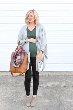 Thanksgiving is a tough holiday to dress for. You want to be comfortable to accommodate all of the food you're going to eat..but you also want to be cute! Here's a cute maternity outfit for the holiday. Black leggings and a blanket wrap, plus cute booties. #maternityclothes