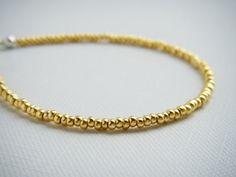 Gold tiny beaded bracelet friendship bracelet seed by juditpukkai Use coupon code on Etsy: PIN10 to get 10% discount :-) Beaded Jewelry, Handmade Jewelry, Beaded Bracelets, Unique Jewelry, Handmade Gifts, Pj, Friendship Bracelets, Coupon, Gold
