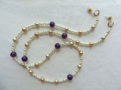 This handcrafted eyewear chain is decorated with Amethyst gems and pearls. Perfect for sun or eyeglasses! Visit arepaki.etsy.com