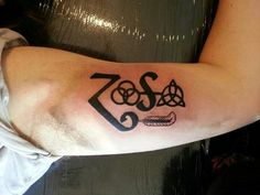 What does led zeppelin tattoo mean? We have led zeppelin tattoo ideas, designs, symbolism and we explain the meaning behind the tattoo. Music Symbol Tattoo, Music Tattoos, New Tattoos, I Tattoo, Tattoos For Guys, Tattoo Quotes, Tatoos, Led Zeppelin Symbols, Led Zeppelin Tattoo