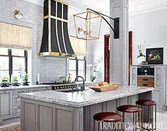 Loving this gorgeous grey and brass kitchen. Show house kitchens are always pretty fun because they showcase the best that many companies have to offer all in
