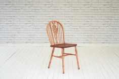 A single hoop backed kitchen chair with carved wheel centre slat detail