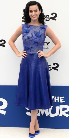 At The Smurfs premiere, Katy Perry arrived in an all-blue ensemble that proved fitting for the occasion: A cobalt blue hand-cut leather and beaded lace Tadashi Shoji dress and Pedro Garcia pumps.