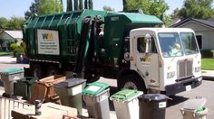 WM Waste Management garbage truck in action