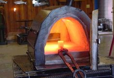 Forge by -- Homemade forge constructed from sheetmetal, steel plate, refractory cement, and a burner. http://www.homemadetools.net/homemade-forge-31