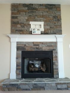 Stone work as an accent above the fire place (and cable/electrical outlets are ready for a TV) by FayNewHomes, via Flickr
