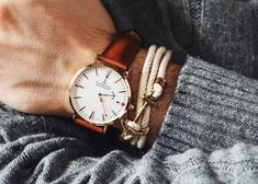 KJP anchor bracelet and watch. Love the tan watch strap with the grey jumper.
