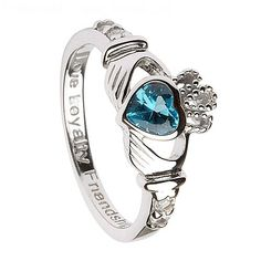 The December birthstone Claddagh ring has a beautiful heart-shaped blue topaz cz stone and the Sterling silver band has the words; Love, Loyalty and Friendship etched on the inside of the band. These are of course the three core values the Claddagh ring has always represented. Blue topaz is also thought to represent creativity and inspiration, a beautiful gift for the woman in your life.  Material: Sterling Silver Weight: 2.5 grams Height: 10mm  Center Stone: Blue Topaz CZ Dimensions: 5mm…