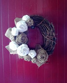 Burlap and Muslin Rosette Wreath.  Could add some color with different fabrics.