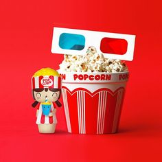 Movie themed momiji doll. Props: 3D glasses, red and white striped popcorn bucket. (instagram.com/lalafriends.)