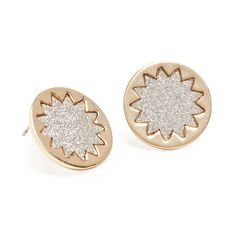 You'll shine as bright as the sun in these modern stunners. Beachy silver sparkle peers out, framed in a contrasting gold sunburst. These art-deco inspired studs are an ideal go-to for your holiday party season.  Find it on Splendor Designs