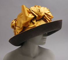 Woman's hat | United States, circa 1910 | Materials: straw, gold silk satin ribbon | Philadelphia Museum of Art