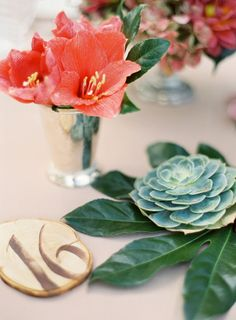 All of the florals on this Style Me Pretty wedding are beautiful ~ be we especially love the dark green leaves used with the succulents. Paired with the corals ~ gorgeous! Photography by josevillaphoto.com, Floral Design by chestnutandvine.com