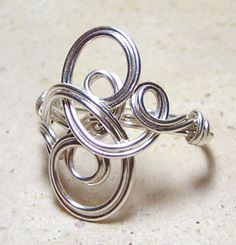 I think you could use wire and make this into a bracelet style instead of a ring.  Super cute!