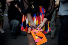 colorful geometric patterned skirt with sheer black blouse