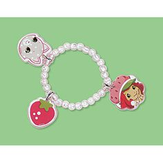 The delicious look of a bright red strawberry and the sweet face of Custard the cat are included on this Strawberry Shortcake Charm Bracelet.