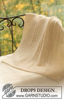 A very nice version of old shale stitch in this elegant baby blanket - the garter border is finished with a delicate detail of crocheted scallops.  DROPS Design