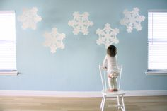 Winter art projects for kids that work perfectly as holiday decorations are great for keeping the kids busy as they simultaneously help mom out. Make a Super-Sized Flakey Snow Craft garland to magnify the fun that winter brings. Winter Art Projects, Easy Christmas Crafts, Winter Kids, Christmas Crafts For Kids, Christmas Projects, Simple Christmas, Kids Crafts, Christmas Decorations, Snowflake Decorations