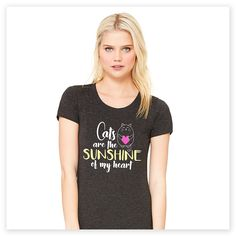 """When you're a cat lover, everything about them makes you happy. This adorable """"Cats are the Sunshine of My Heart"""" tee sums that sentiment up purr-fectly. Super-soft, ultra-comfortable shirt in a charcoal grey color is made of 50% poly, 25% combed and ring-spun cotton and 25% rayon. Design exclusive to Zee & Zoey's Cat Creations!"""