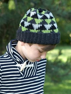 Free Pattern - Kids stay warm and look cool this winter in this cozy #crochet hat, featuring an on-trend Navajo-inspired pattern.