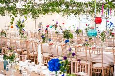 Vintage wedding tent with branches covered in leaves hanging from the roof