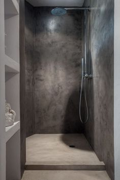 These folks DO like concrete showers - just seal it well. Others were mentioning water impacts breaking it up over time? Love this rich light/color, though.