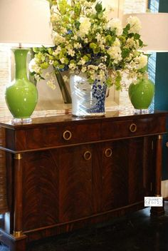 Sideboards make for dramatic displays. Add a pair of lamps and a stunning floral for an easy but jaw dropping effect.