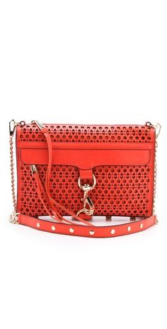 I'm not into Rebecca Minkoff, but love the perforated look... Rebecca Minkoff Triangle Perforated MAC bag in persimmon leather.