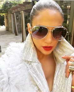 6e17729e64 Jennifer Lopez wearing Quay Needing Fame Sunglasses and Rd Roth Textured  Jacquard Coat