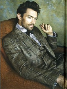 Hugh Jackman in a bold checkered 3 piece suit.
